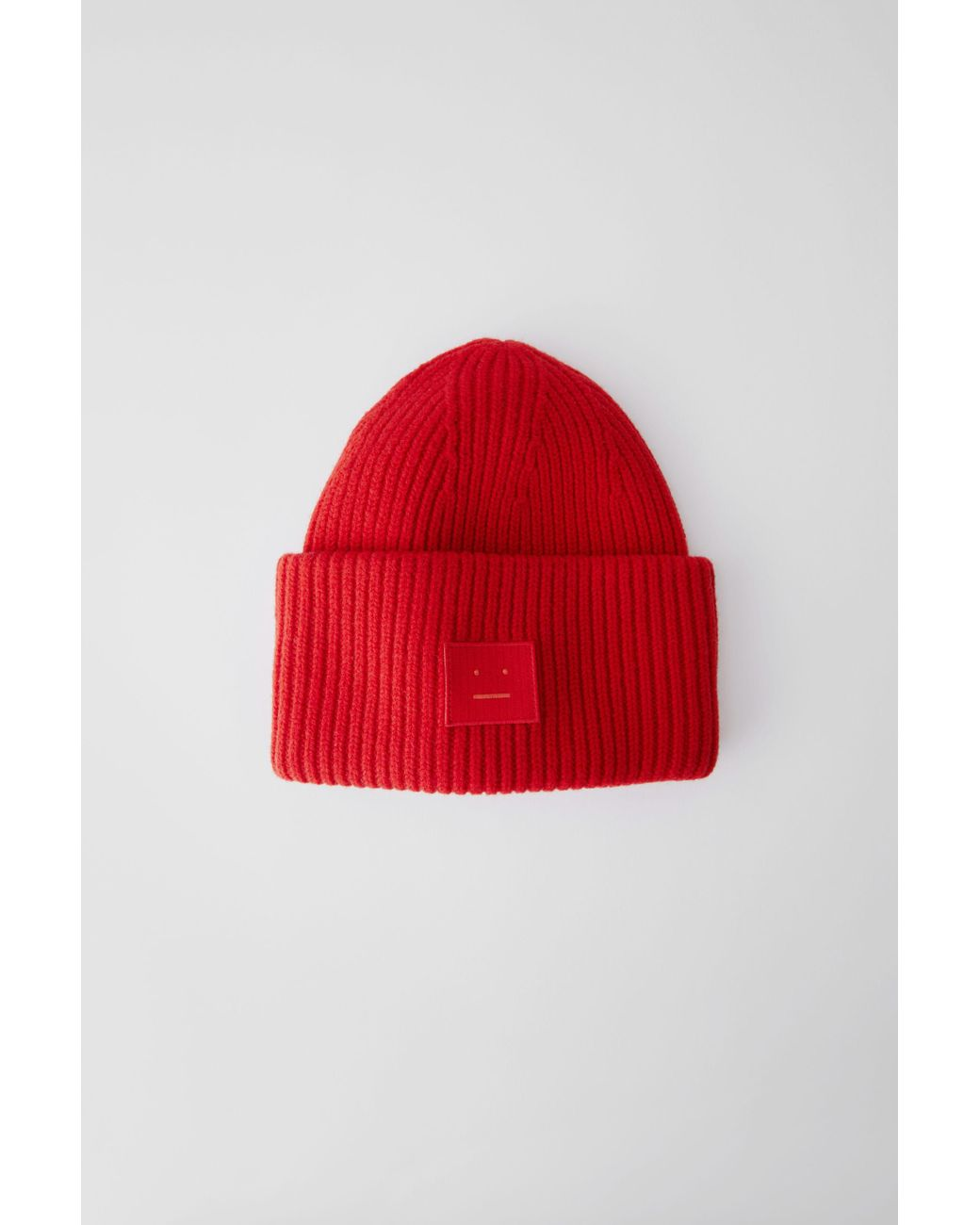 4d5422345c4 Acne Studios Pansy Face Tomato Red Ribbed Beanie Hat in Red for Men ...