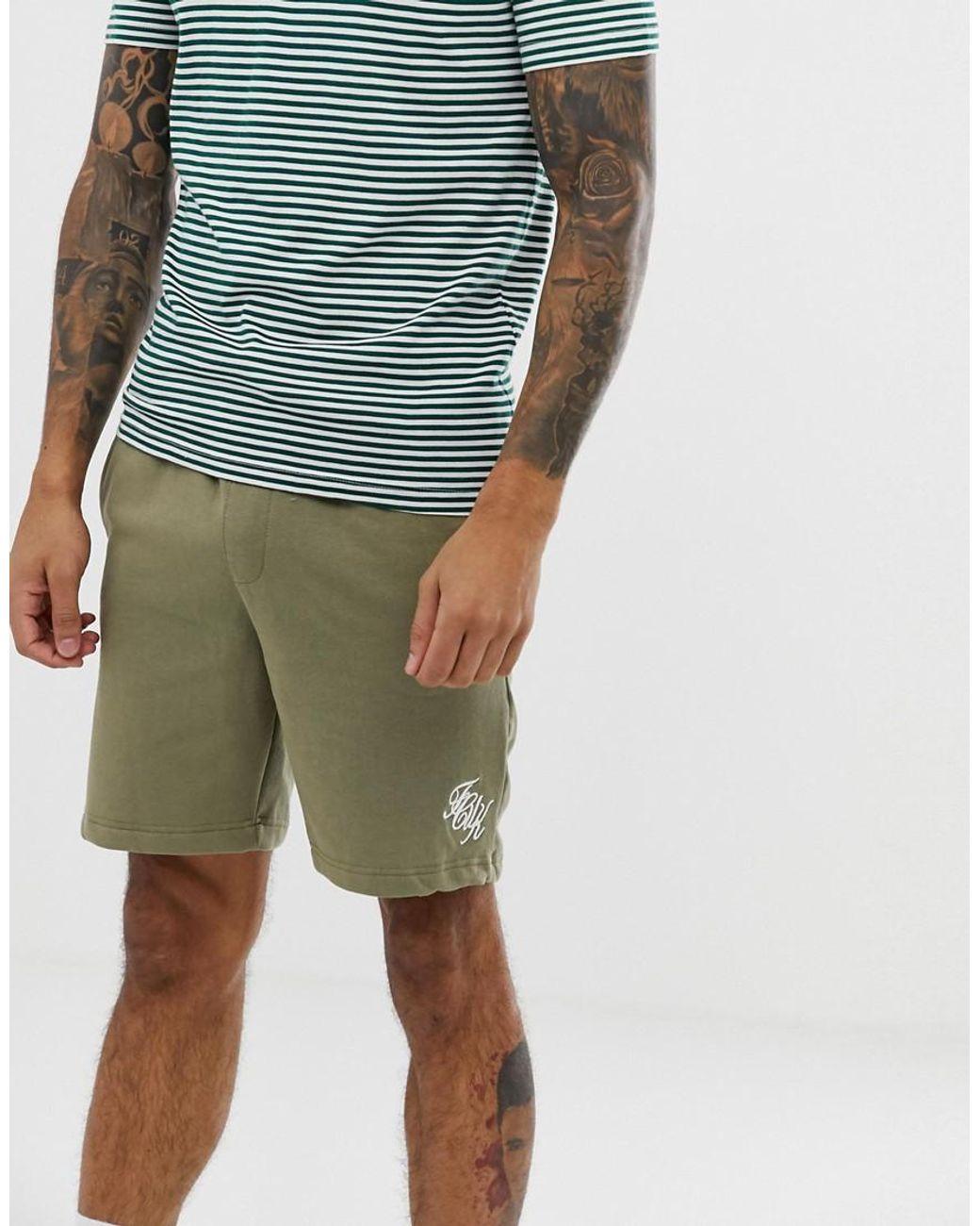 Pantalones cortos de punto con logo de hombre de color verde