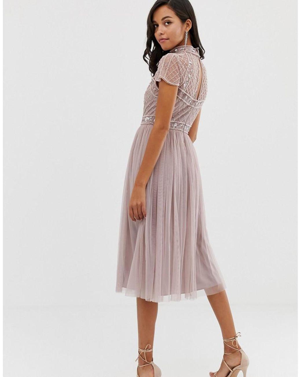 311f71630 Vestido midi con top corto adornado y falda de tul de mujer