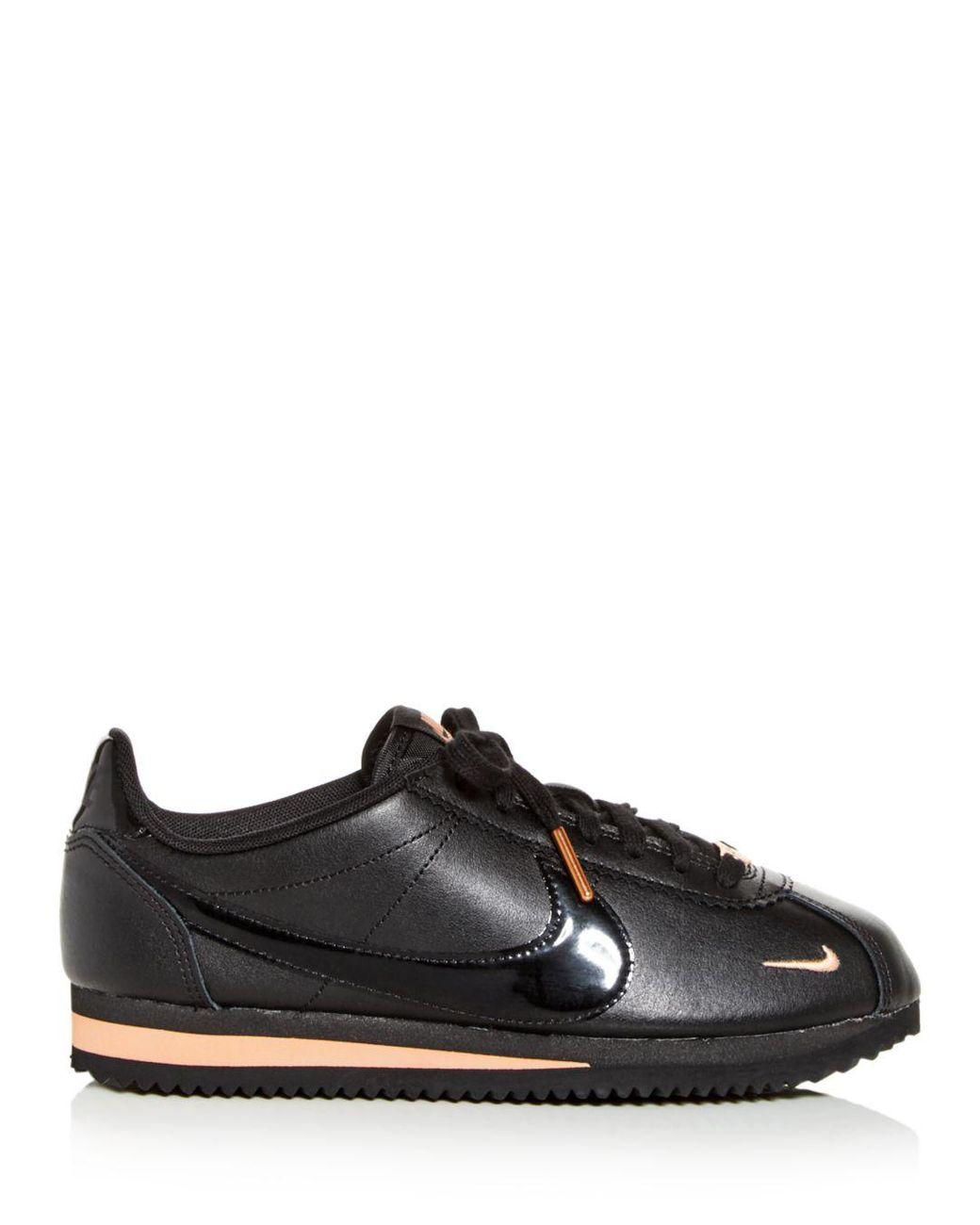 online retailer 09dbe 1261c Black Women's Classic Cortez Premium Low - Top Sneakers