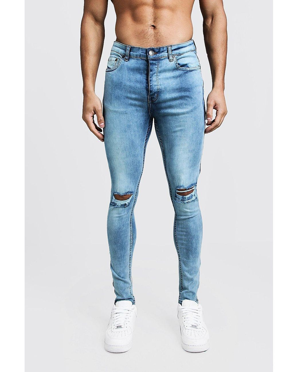 a293effcbfd3 Lyst - BoohooMAN Super Skinny Ripped Knee Jeans With Zip Hem in Blue ...