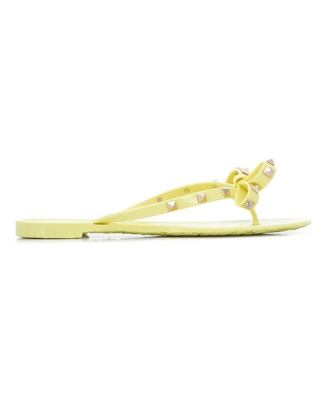7c75d95858b2 Lyst - Valentino Garavani Rockstud Bow Flip Flops in Yellow