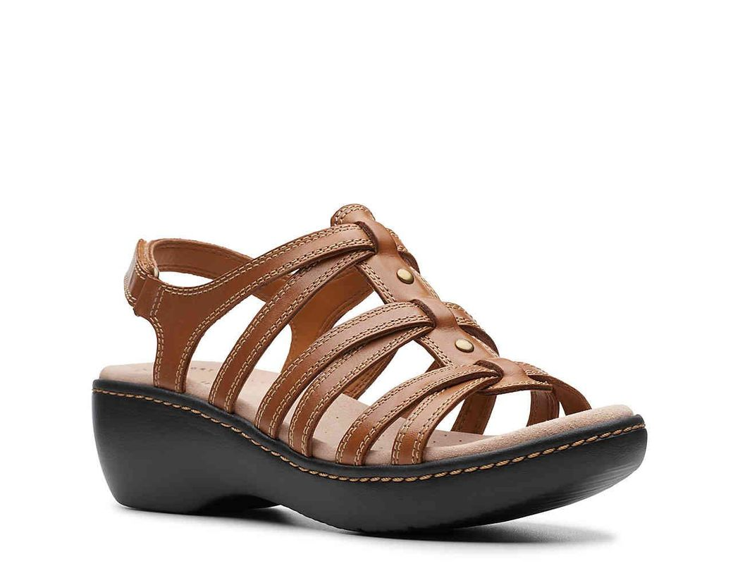 6802fba1f34c Lyst - Clarks Delana Curve Wedge Sandal in Brown