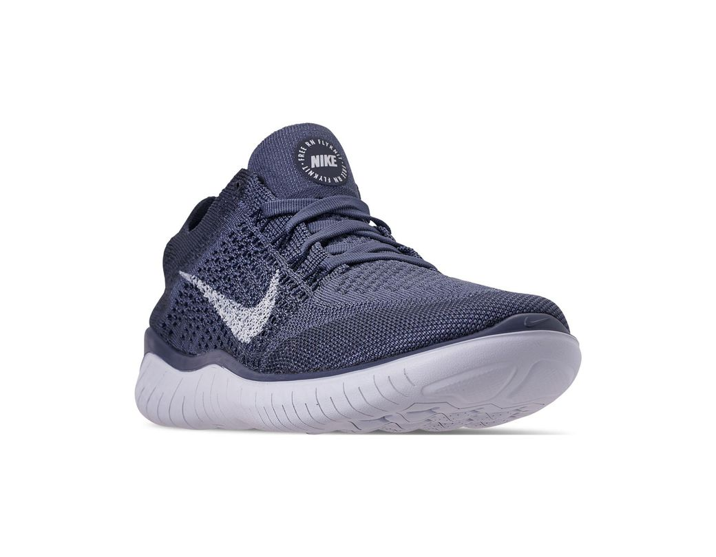 98852029be59 Nike. Men s Blue Free Rn Flyknit 2018 Running Sneakers From Finish Line