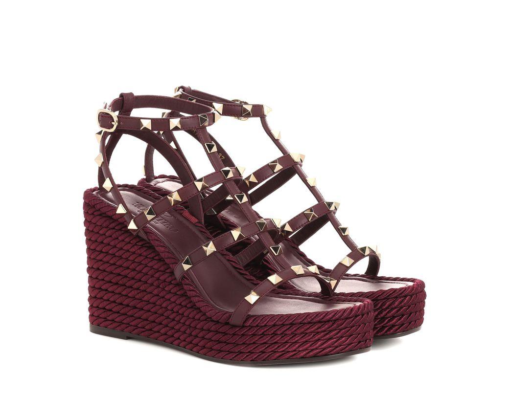 1b5f78b661ac Valentino. Women s Torchon Leather Wedge Sandals