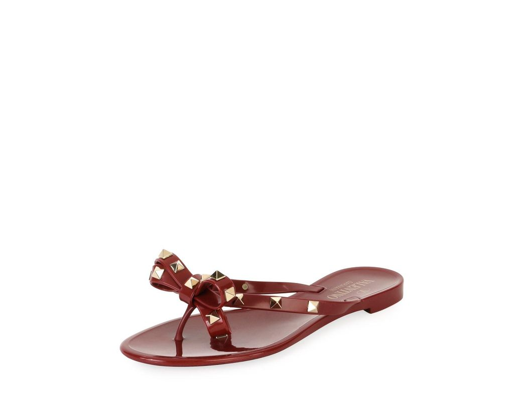 9ae79853182f Lyst - Valentino Jelly Rockstud Flat Thong Sandals in Red - Save 19%
