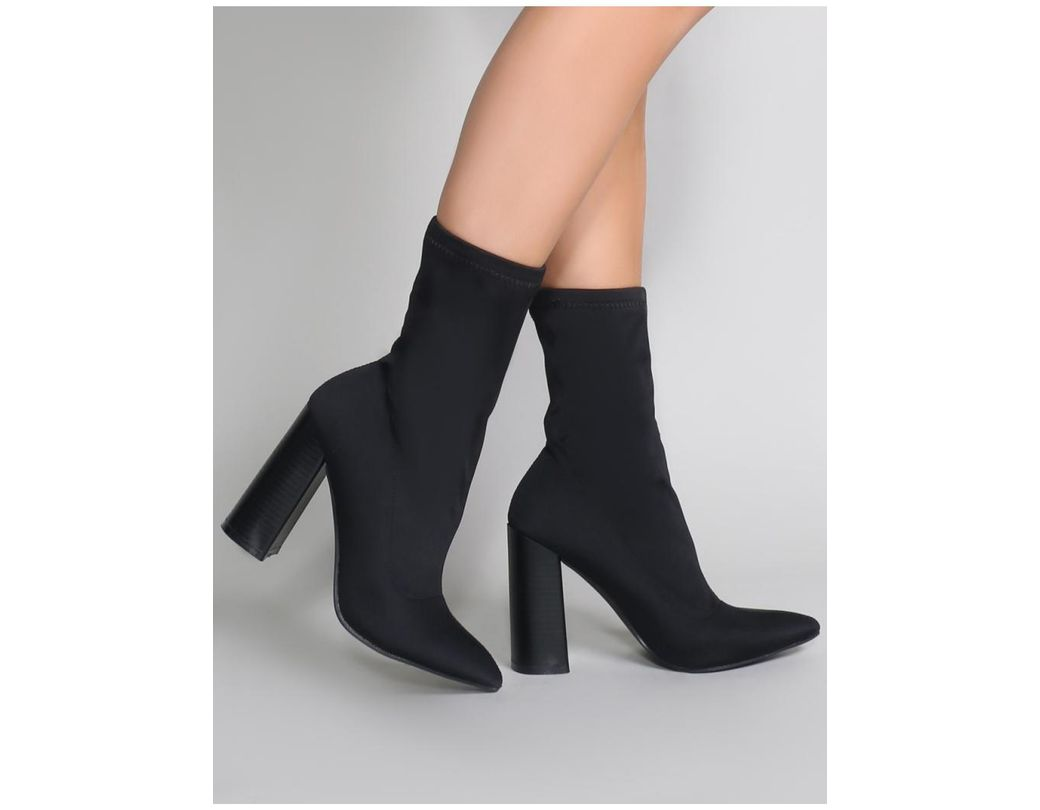 6d1ad831cff2 Public Desire Libby Flared Heel Sock Fit Ankle Boots In Black ...