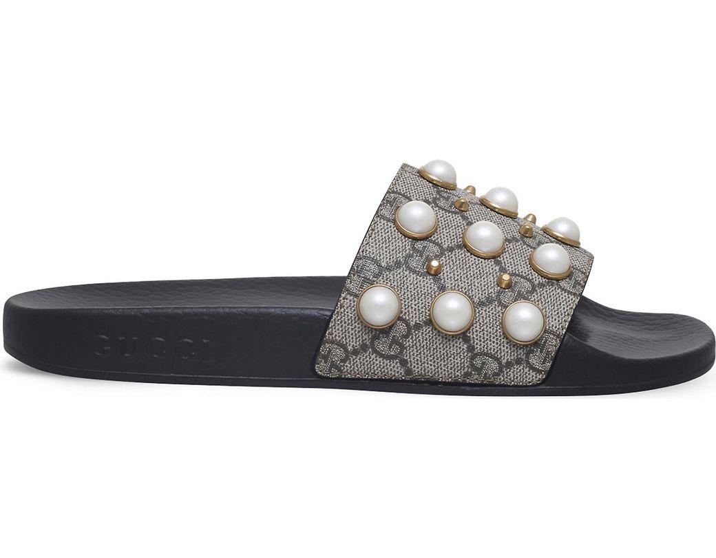5206d34c8e91 Lyst - Gucci Pursuit Pearl-embellished Rubber Slider Sandals