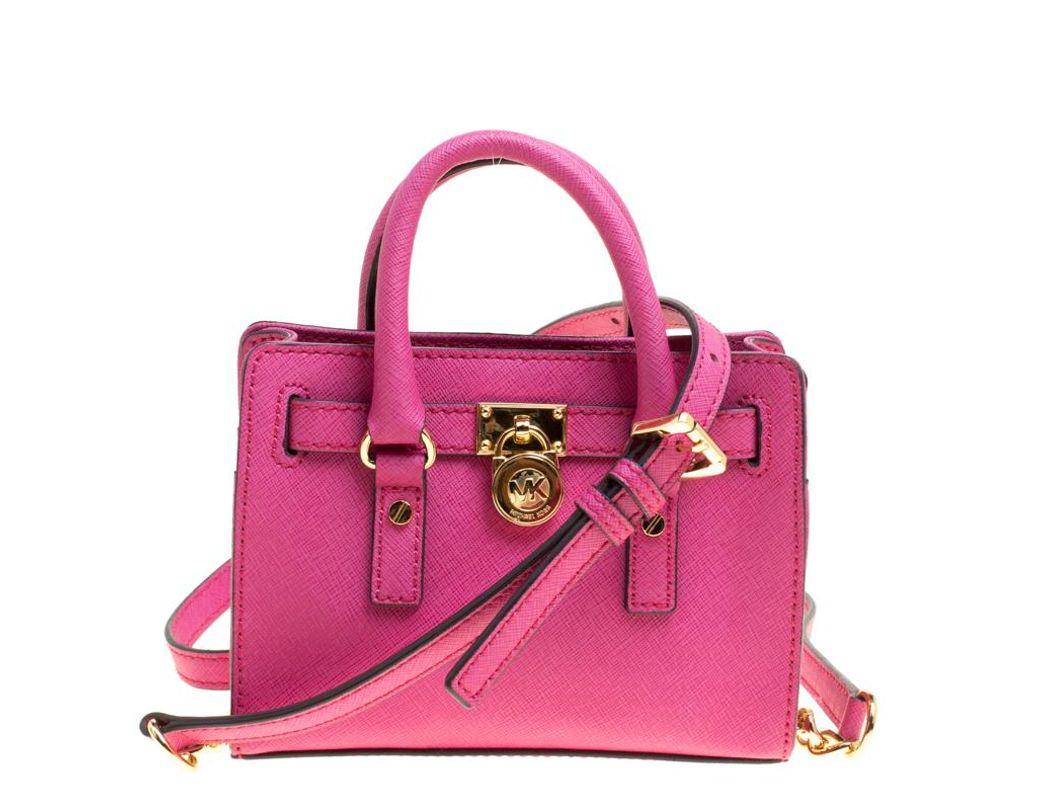 5a9f163f04ca MICHAEL Michael Kors. Women s Hot Pink Saffiano Leather Mini Hamilton  Crossbody Bag