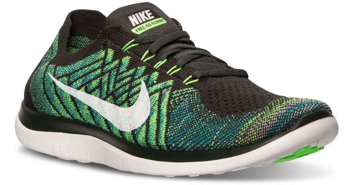 6d428fba28625 Lyst - Nike Men s Free 4.0 Flyknit Running Sneakers From Finish Line in  Green for Men
