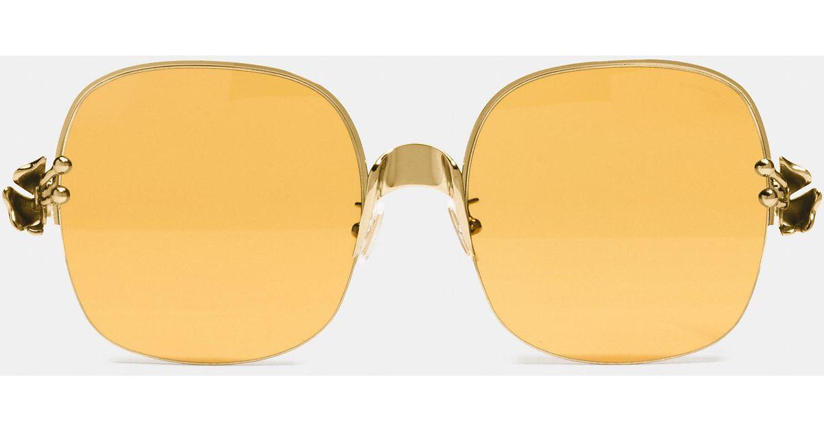 9af50a5cdb9 Lyst - COACH Tea Rose Sunglasses in Metallic