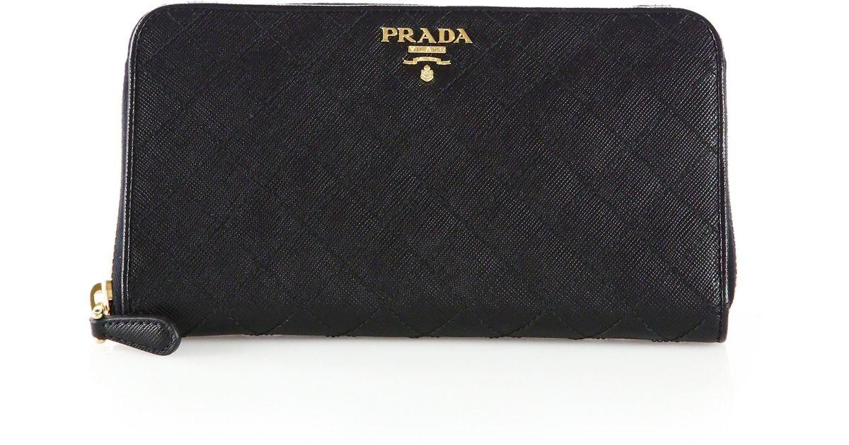 e7f7f51d8a23 ... release date lyst prada quilted saffiano ziparound wallet in black  b282e ddab8