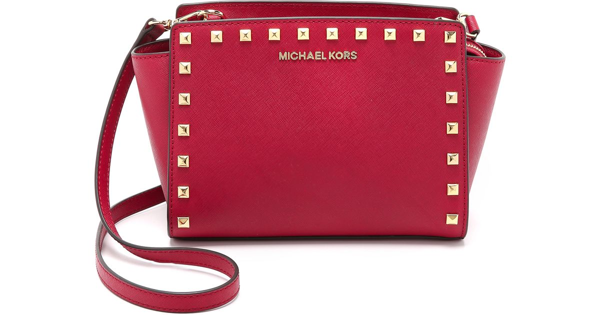 Lyst Michael Kors Selma Stud Medium Messenger Bag Cherry In Red