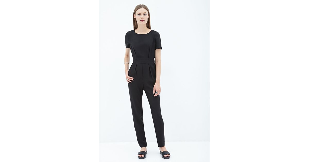 44ee376564a Lyst - Forever 21 Short-sleeved Crepe Jumpsuit You ve Been Added To The  Waitlist in Black