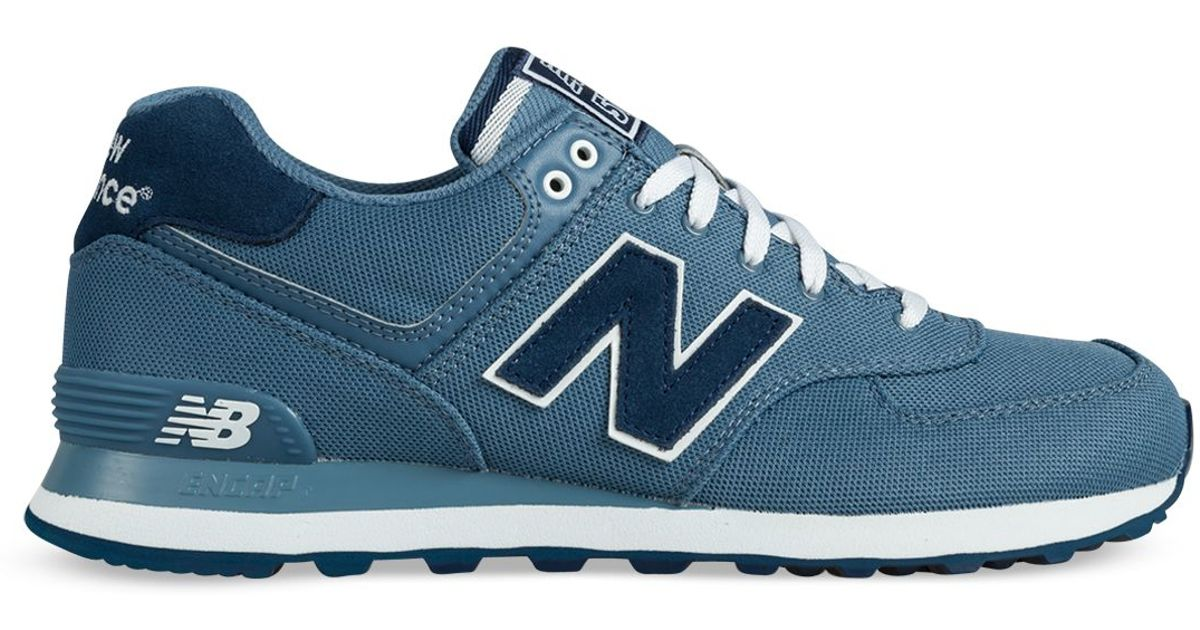 detailed look 610f3 42805 New Balance Blue Polo Pique 574 Sneakers for men