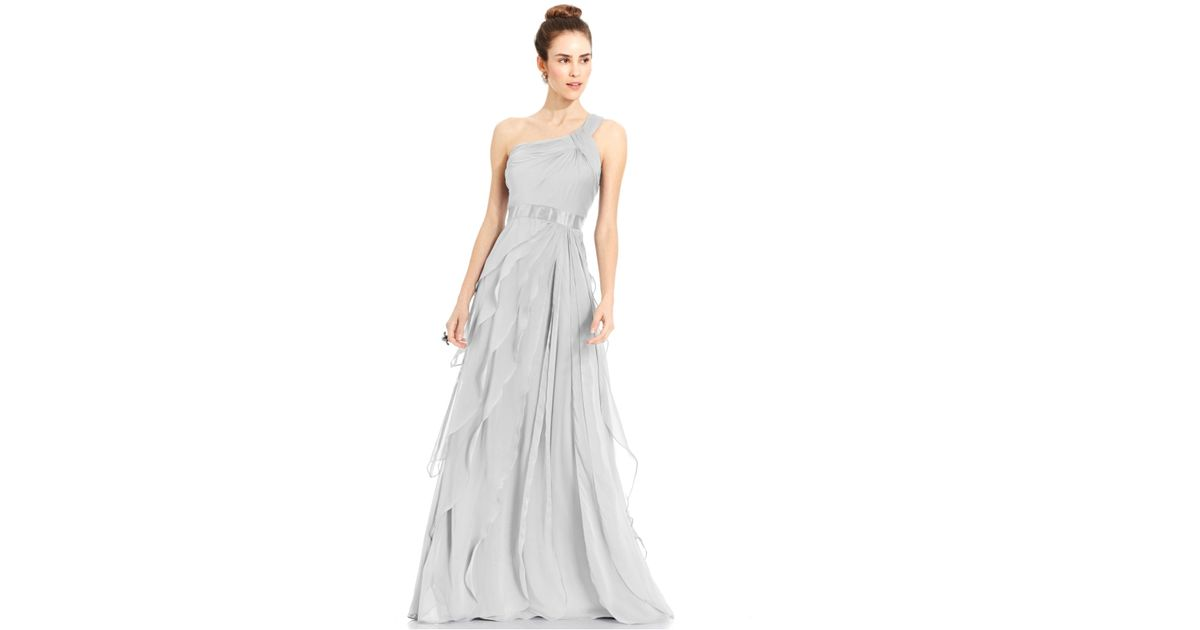 Shruthi In A Dreamy One Shoulder Pronovias Dress: Adrianna Papell One-shoulder Tiered Chiffon Gown In Silver