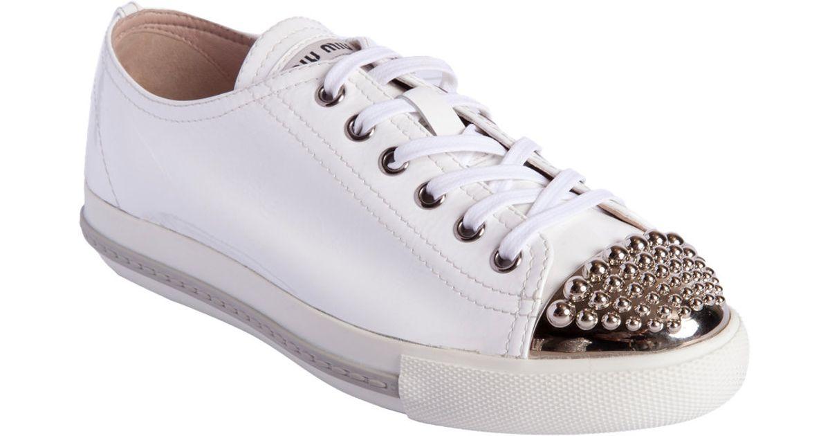 d1d406a4ff31 Lyst - Miu Miu Studded Metallic Cap Toe Sneaker in White