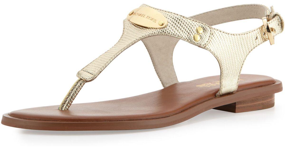 beb9d1c3d177 Lyst - MICHAEL Michael Kors Plate Thong Sandal in Metallic
