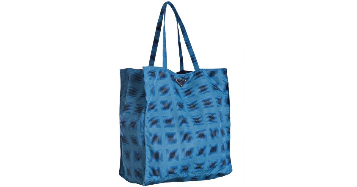 4bd4959a2e ... italy lyst prada blue printed nylon tote bag in blue a6cad f1eb0 ...