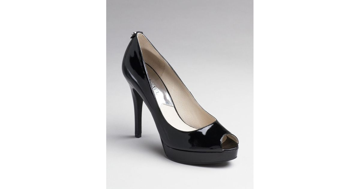 2d33aca2b0 MICHAEL Michael Kors York Platform Black Patent Leather Peep Toe Pump in  Black - Lyst