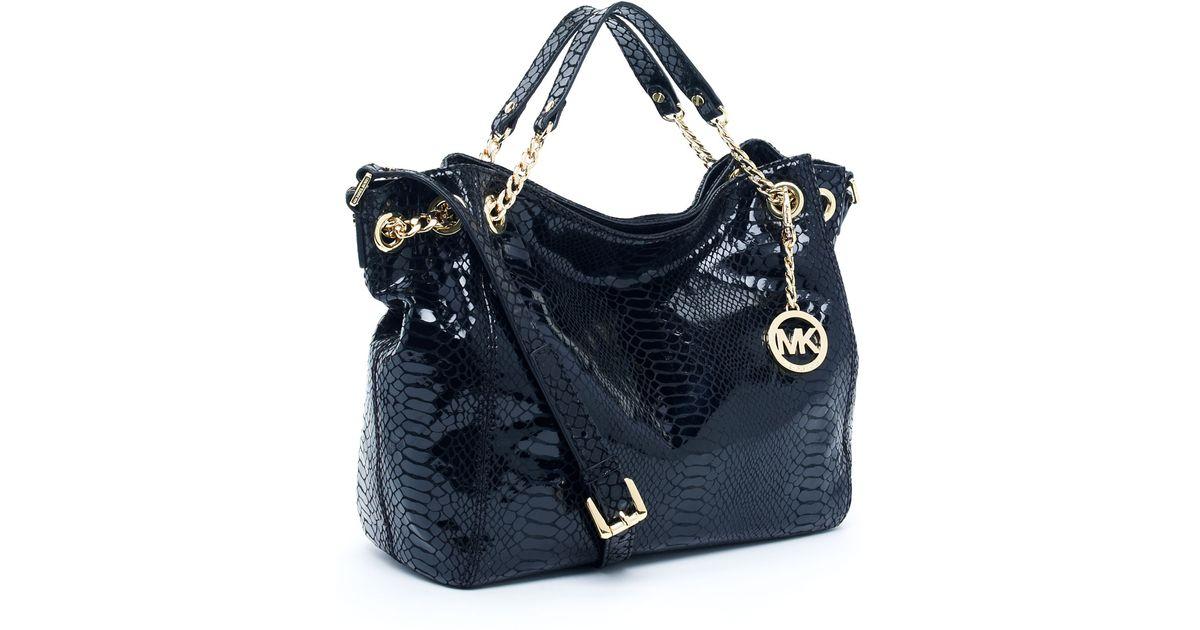 e22f65cec962ea ... satchel in vanilla discount code for lyst michael kors jet set chain  shoulder tote python embos 54a5d ceb22 ...