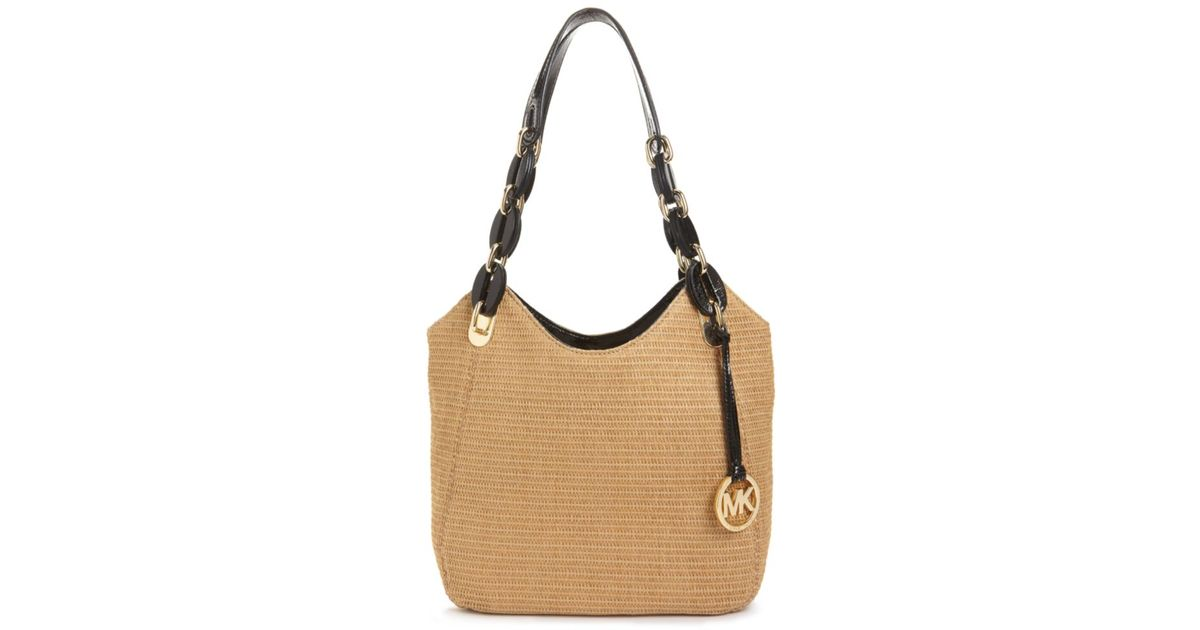 1e11bd715b60a4 Lyst - Michael Kors Lily Medium Straw Tote in Brown