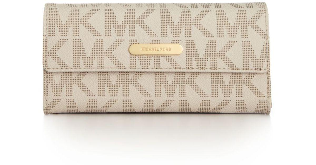 7ce6cca95471 Lyst - Michael Kors Logo Large Slim Flap Wallet in White
