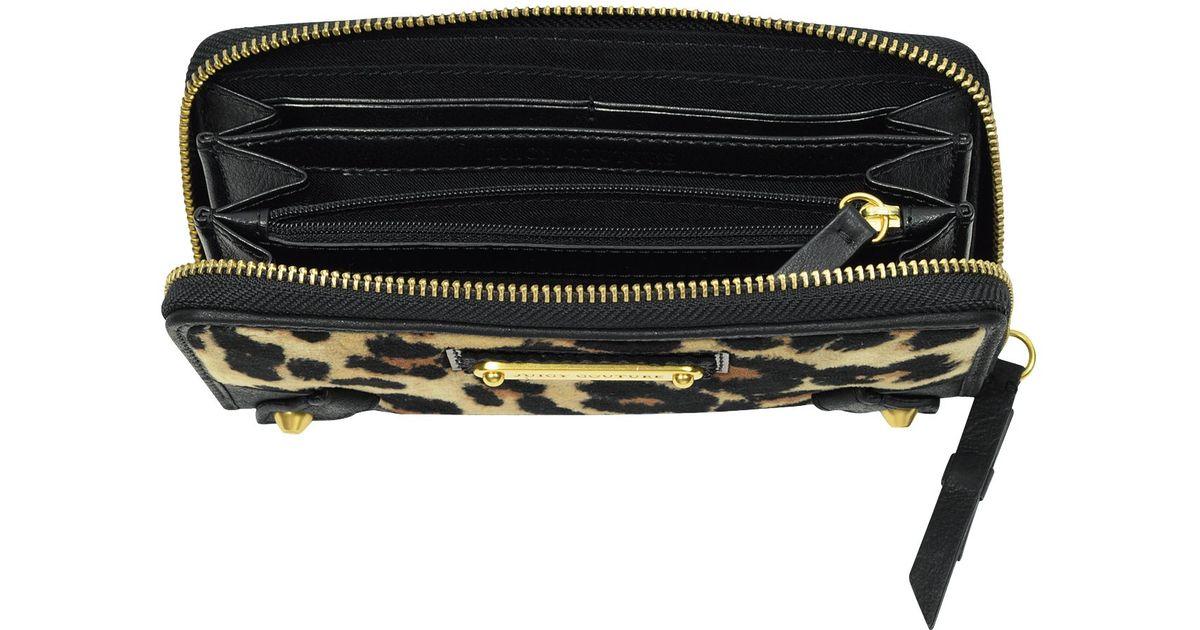 Juicy Couture Animal Print Zip Around Wallet in Purple - Lyst 21050cb4f388
