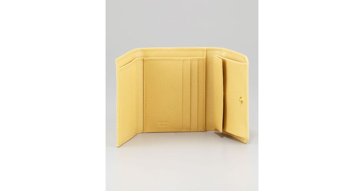 817c643beb2311 ... closeout lyst prada small french wallet in yellow 3a14d 58bd9 ...