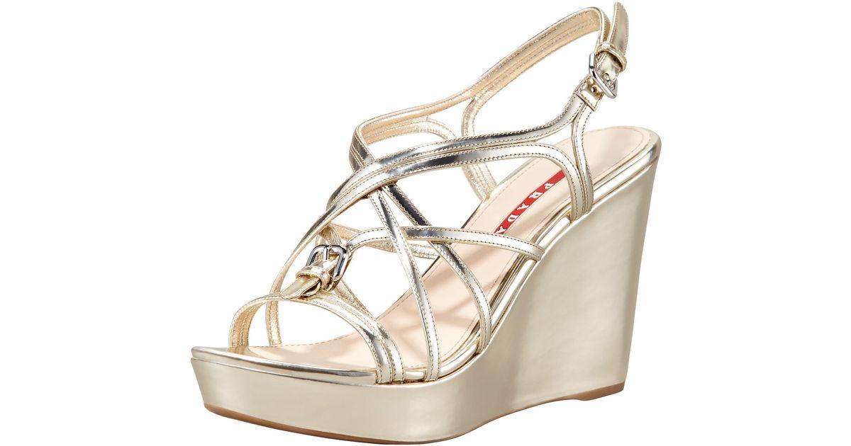 64821c0c51d4 Lyst - Prada Metallic Strappy Wedge Sandals in Metallic