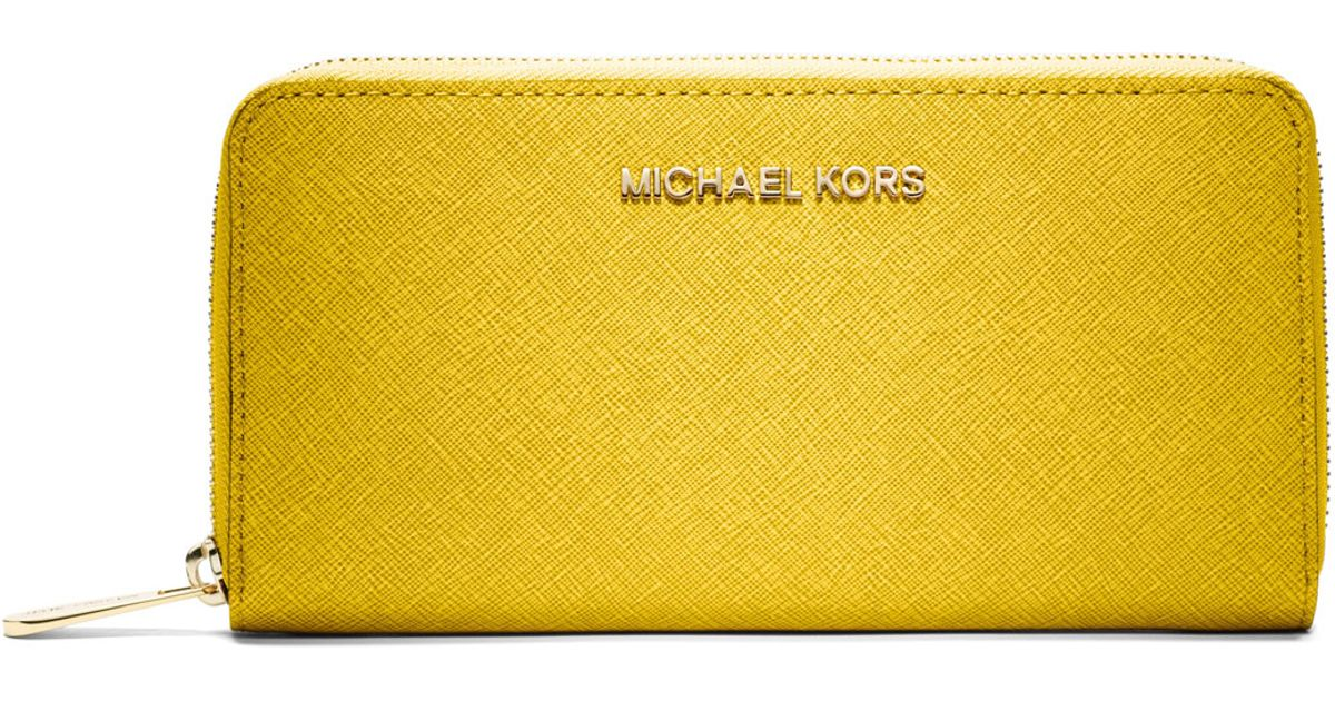 91f2e80b17d3 MICHAEL Michael Kors Jet Set Saffiano Continental Wallet in Yellow - Lyst