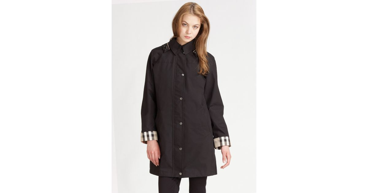 2227bd9a95e2 Lyst - Burberry Brit Hooded Raincoat with Warmer in Black