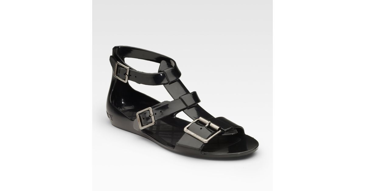 4a3e0afdc68d Lyst - Burberry Jelly Flat Sandals in Black
