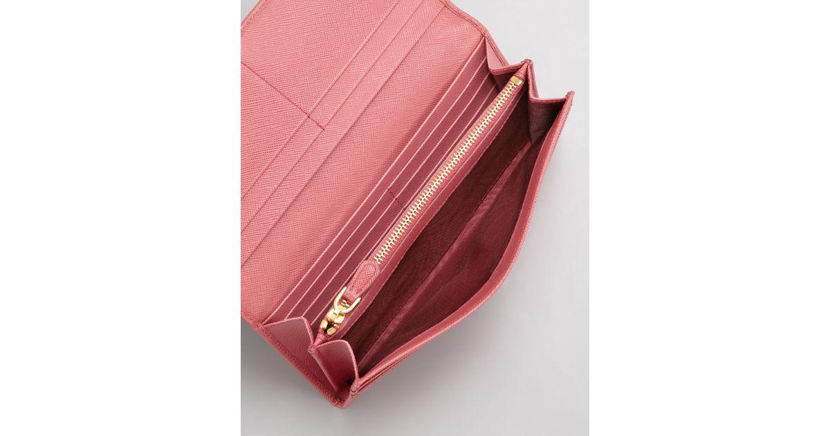 4501b7c8e644 Lyst - Prada Saffiano Triangle Continental Flap Wallet in Pink