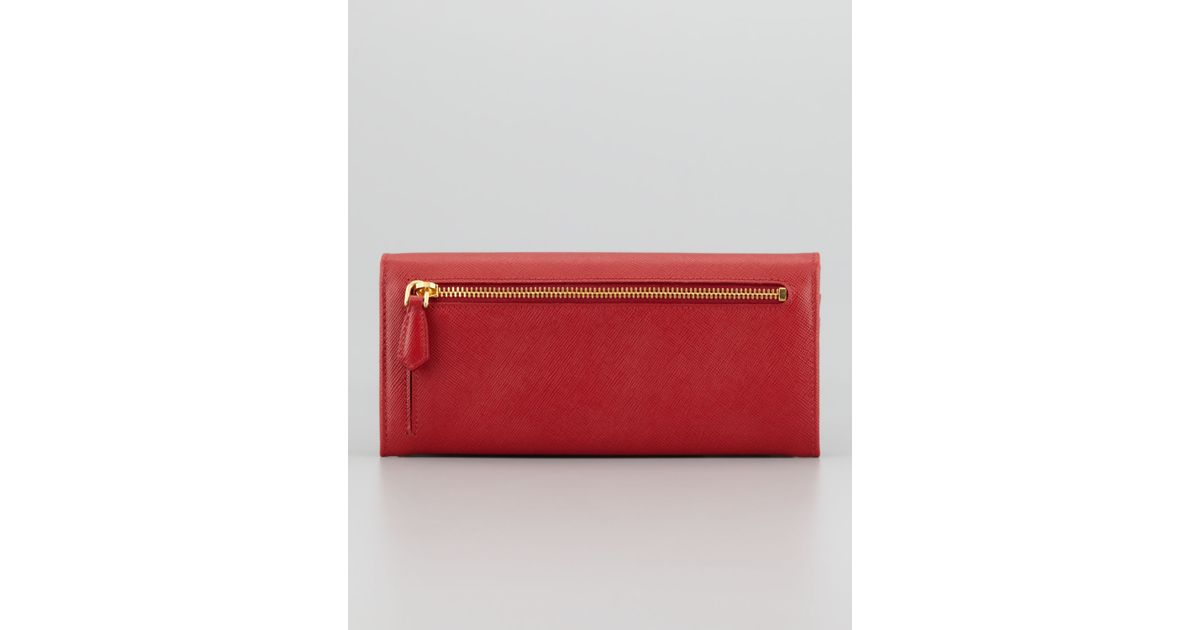 f6d1800513d9 ... ireland lyst prada saffiano triangle continental flap wallet in red  79e68 117dc