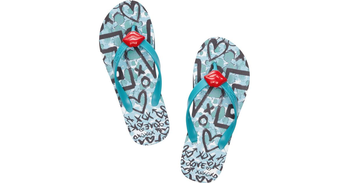 33047310a8ed10 Lyst - Miss Trish Smooch Rubber Flip Flops in Blue