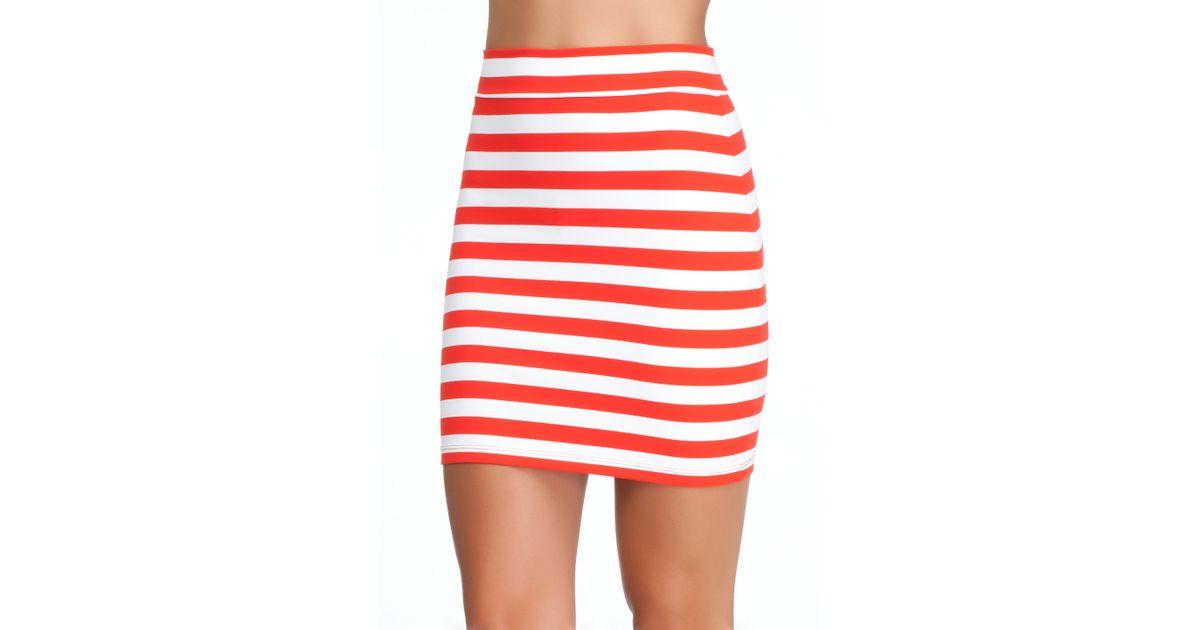 6a21a68ddf Bebe Striped Mini Skirt in Red - Lyst