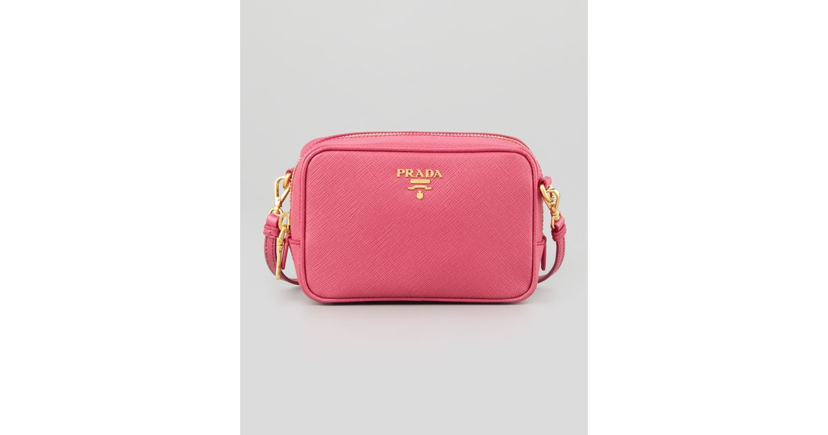 9c4bfe1c6898 Lyst - Prada Saffiano Mini Zip Crossbody Bag in Pink