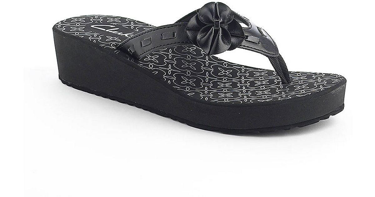 f5dc89707a Lyst - Clarks Skiff Kitts Wedge Thong Sandals in Black
