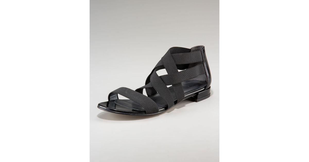 3520ef556 Lyst - Stuart Weitzman Elastic Strappy Flat Sandal in Black
