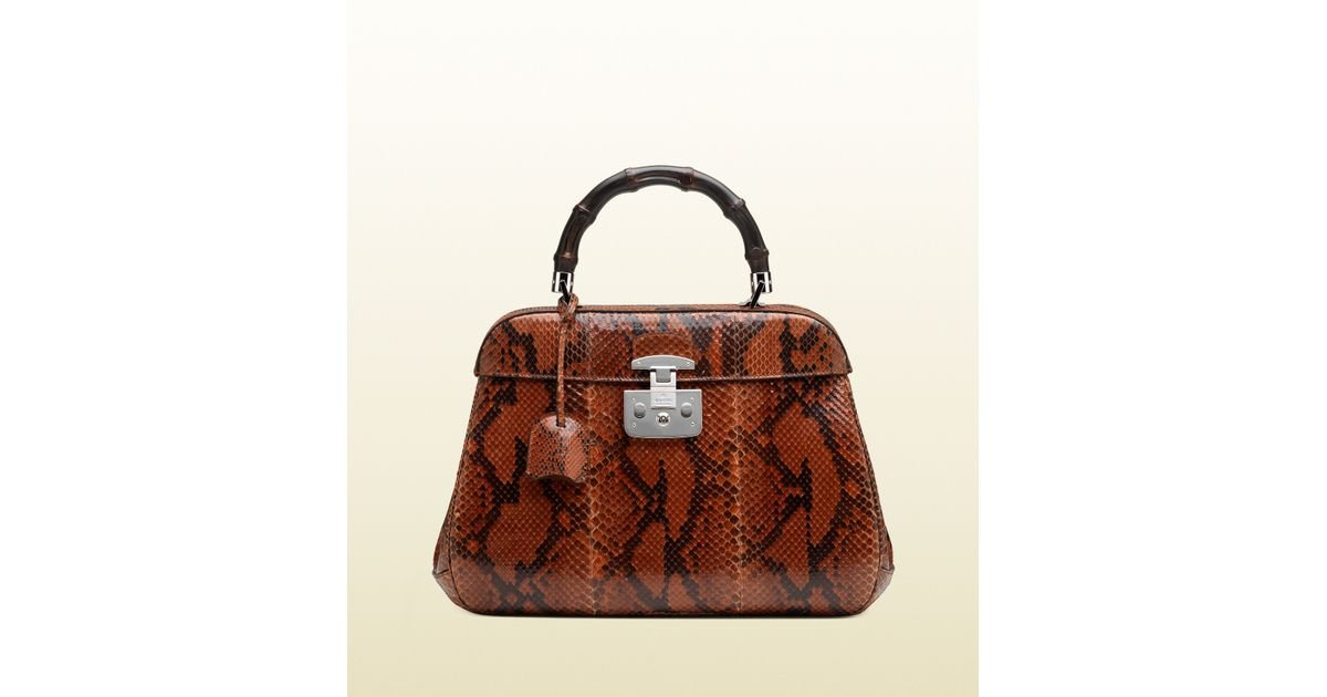 0a4250495a0 Lyst - Gucci Lady Lock Python Top Handle Bag in Brown