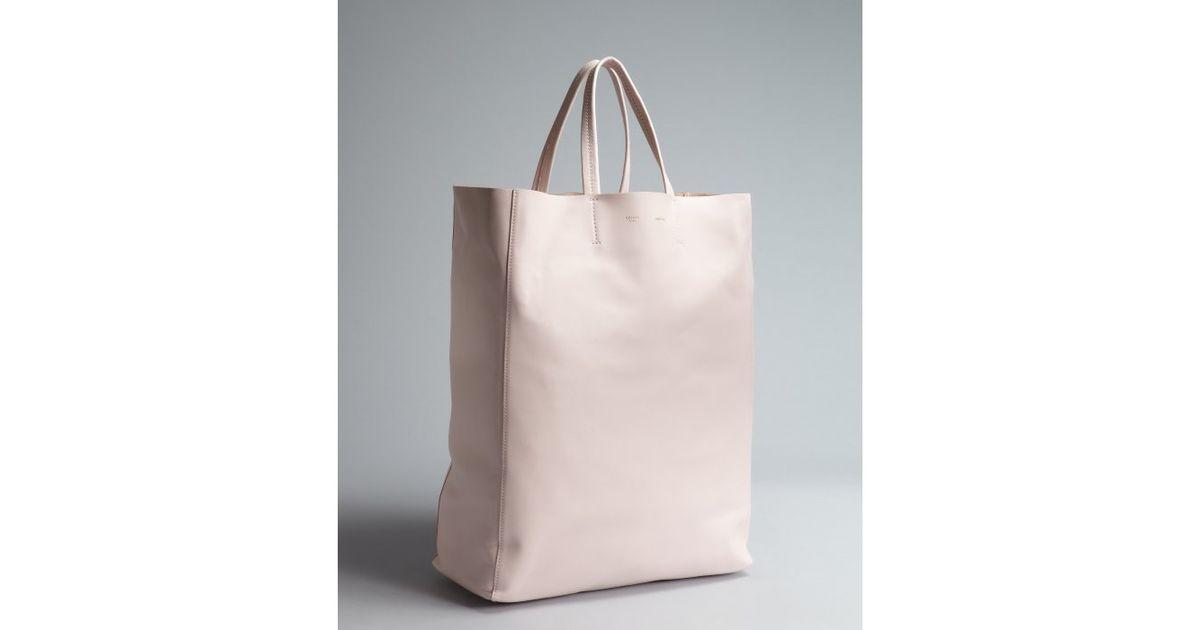 celine powder pink clutch