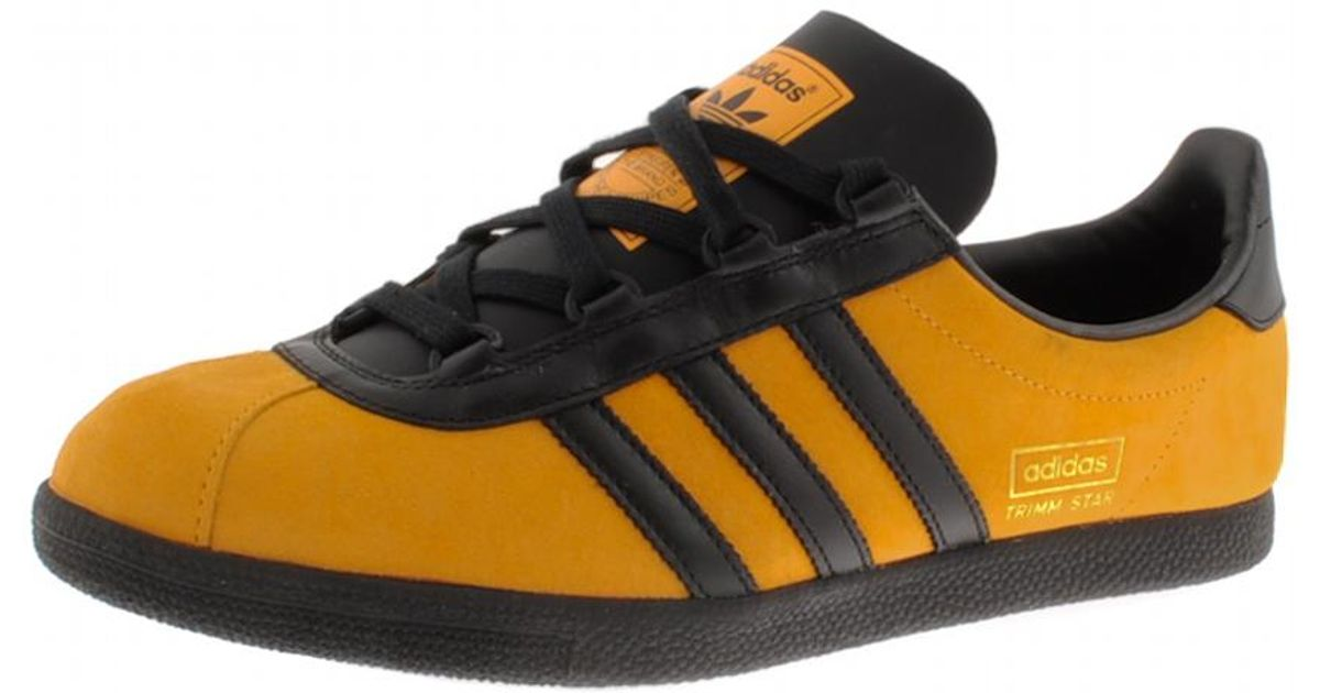 yellow and black adidas trainers