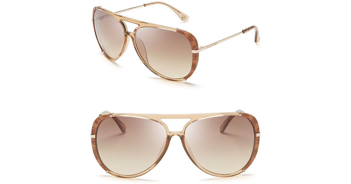 f0b25e537a6d0 Michael Kors Julia Aviator Sunglasses in Natural - Lyst