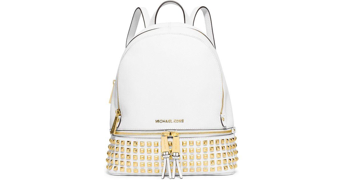 631486aecfc3 ... france lyst michael michael kors rhea small studded leather backpack in  metallic 57782 8967b