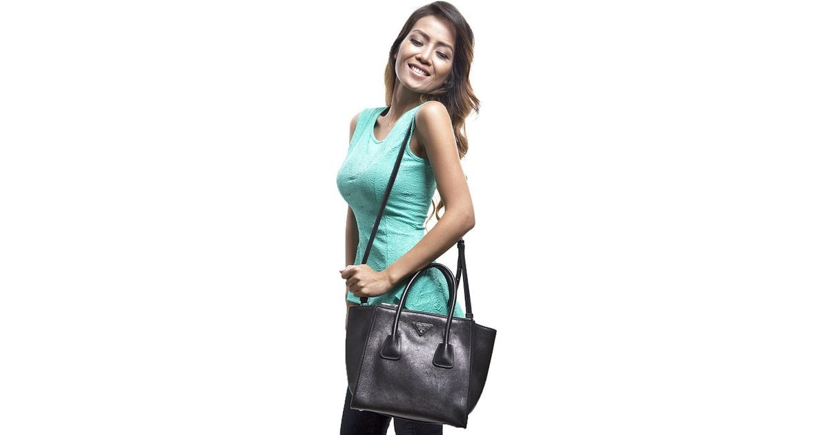 7700bb384c2c ... promo code for lyst prada pre owned black glace calfskin twin pocket tote  bag in black ...