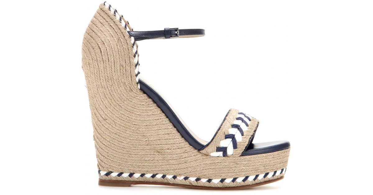 f87f3333b8b Lyst - Gucci Embroidered Wedge Sandals in Natural