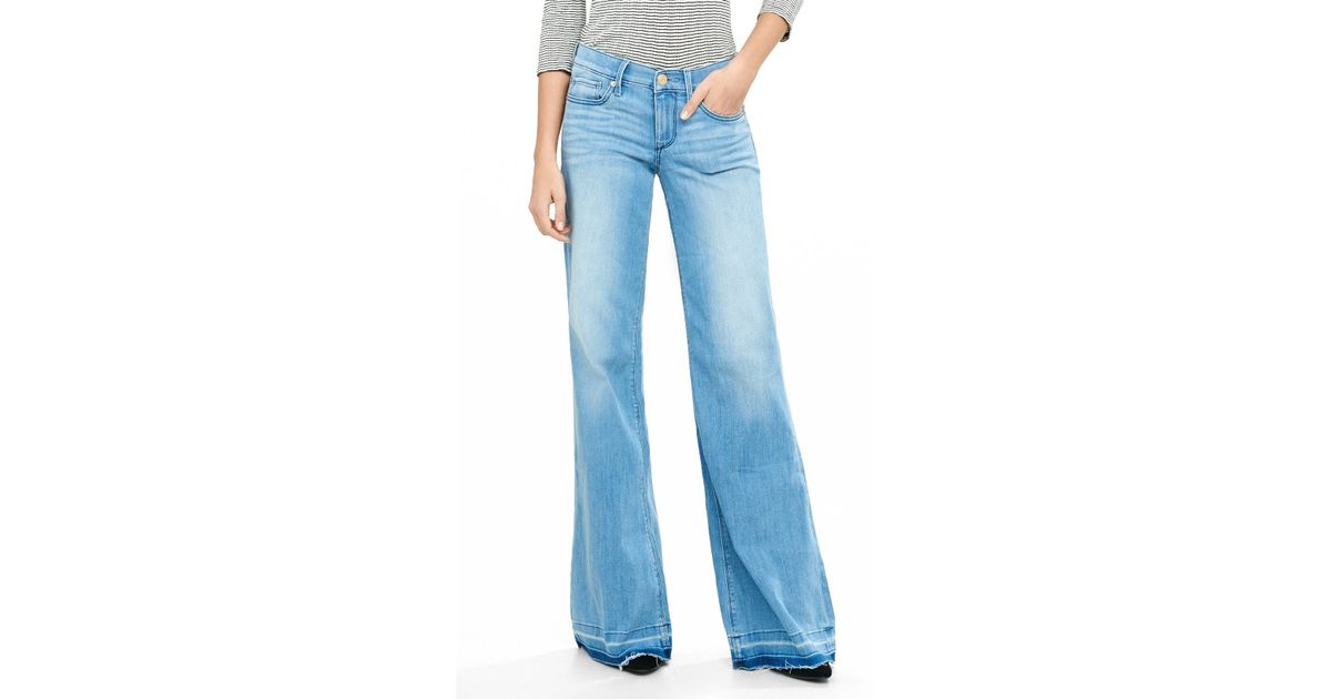 Lyst express mid rise released hem wide leg flare jean for Express wash roma