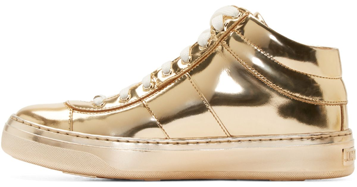 209c3daa342a ... clearance lyst jimmy choo gold leather sneakers in metallic 64e2d 10530