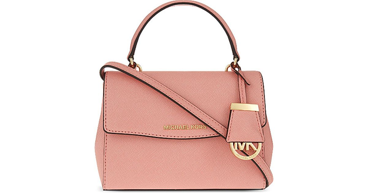 8ca615cb7c12 MICHAEL Michael Kors Ava Extra Small Saffiano Leather Cross Body Bag in  Pink - Lyst